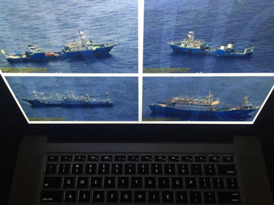Philippines shows photos of Chinese ships in disputed sea