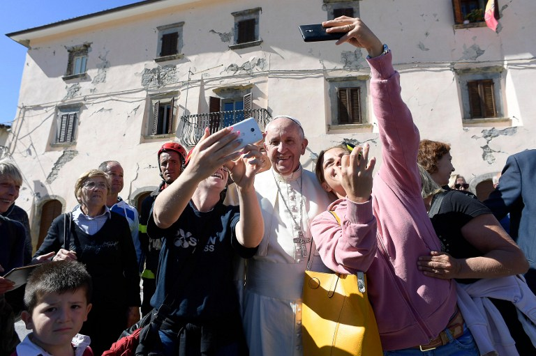 Selfies and prayers as Pope lifts Italy quake survivors