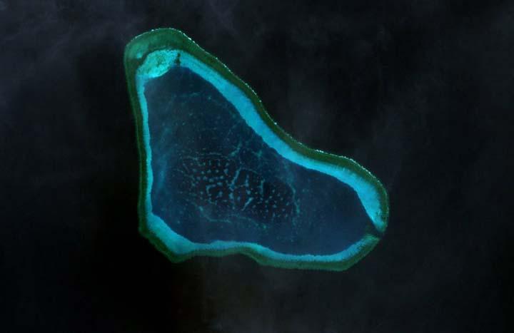 Bajo de Masinloc, also Scarborough Shoal / Photo by NASA [Public domain], via Wikimedia Commons