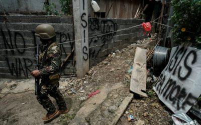 Dusty teddy bear lies in war-ruined Philippine city