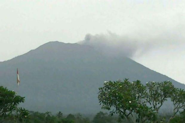Bali volcano spews smoke and ash, raising eruption fears