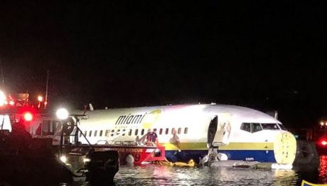 A chartered Boeing 737 jetliner with 143 people on board slid off a runway and into the St. Johns River in Jacksonville, Florida
