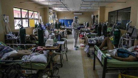 Manila hospitals struggle as virus surges