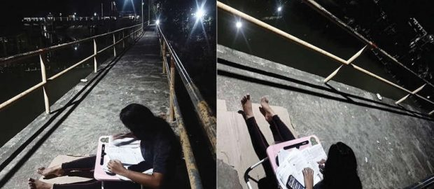 Grade 11 student studying on a bridge